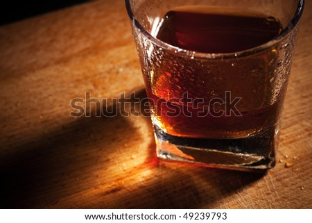 glass from whisky on a wooden table