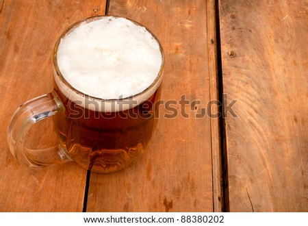 Glass Full of Beer on Old Wooden Table