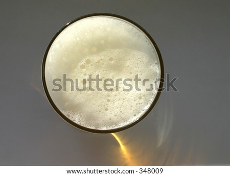 glass full of beer, view from obove, You can see nice sun reflection at the bottom