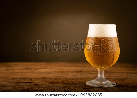 Glass full of cold beer on the wooden table Stok fotoğraf ©