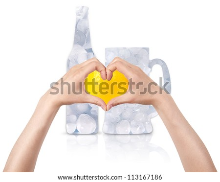 Glass full of ice with the heart  made of two women hands. love beer concept