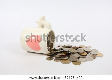 glass full of money on white background #371784622