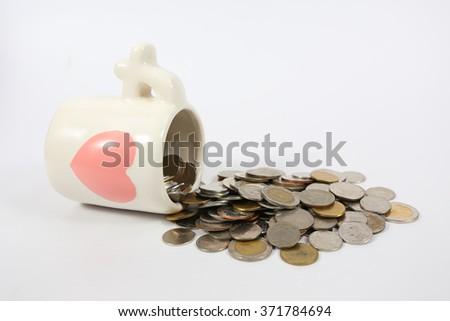 glass full of money on white background #371784694