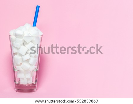 glass full of sugar cubes  ...