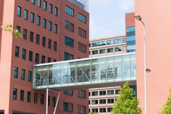glass gangway between two office buildings in rotterdam, netherlands