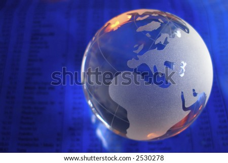 glass globe in front of business numbers