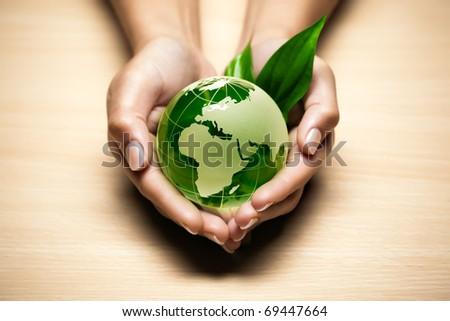 glass globe in hand