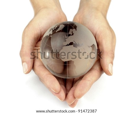 Glass globe in hands