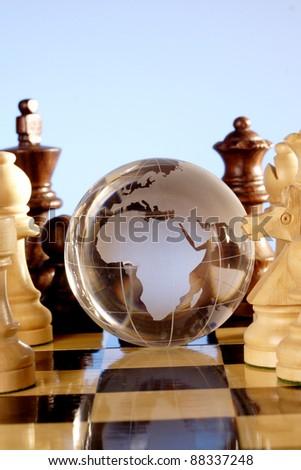 Glass globe on chess board