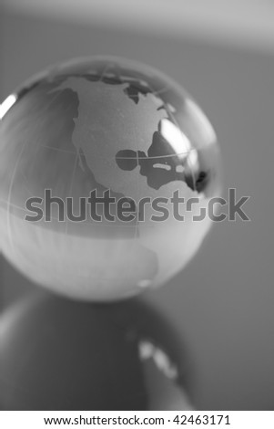 Glass globe on mirror, North and central America visible