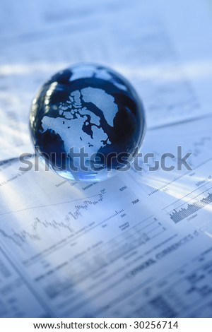 Glass globe with North America and business papers