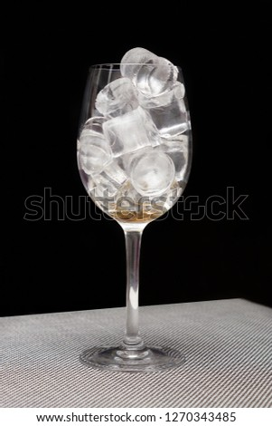 Glass goblet. Glass goblet with ice. #1270343485