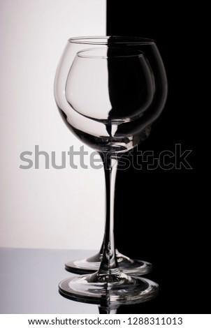 glass goblet in the goblet. Black white background.Yin Yang #1288311013