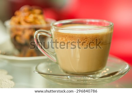 Glass hot coffee cup with white foam surface