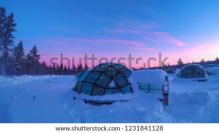 Glass igloo at Kakslauttanen Arctic Resort Finland during magical polar twilight