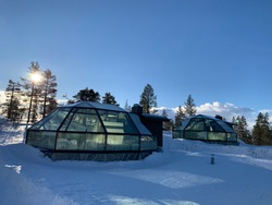 Glass igloos in the winter on a sunny day and lots of snow in Levi, Finland