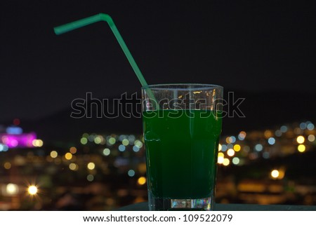 glass in front of defocused lights - stock photo