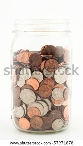 Glass Jar almost Filled with Various Coins