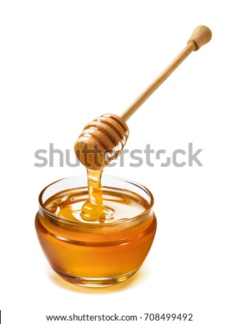 Glass jar and honey dripping from dipper isolated on white background