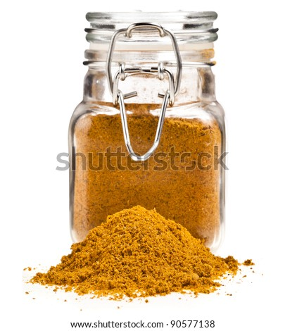 glass jar filled with heap spicy powder close up macro  isolated on white background
