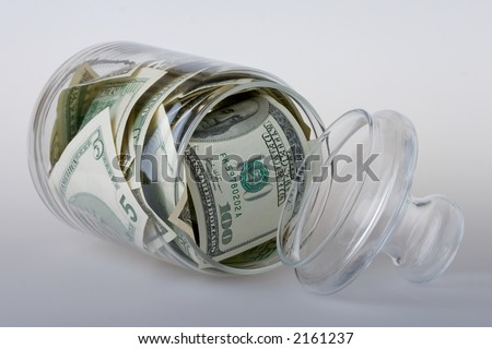 Glass jar full of the American banknotes.