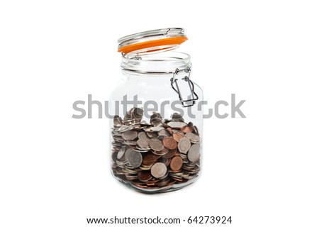 glass jar half full with english coins