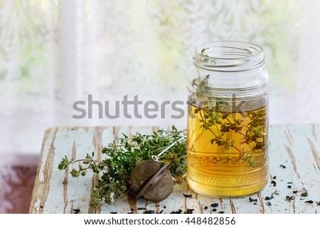 glass jar of hot herbal tea...