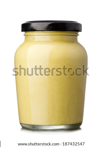 Glass jar of mustard isolated on the white background