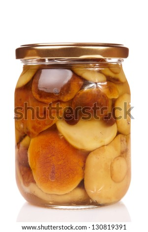 Glass jar of preserved mushroom isolated in white