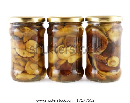 Glass jar of preserved mushroom isolated in white - stock photo