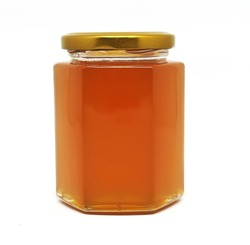 Glass Jar Of Pure Honey