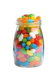 Glass jar of tasty jelly beans on white background
