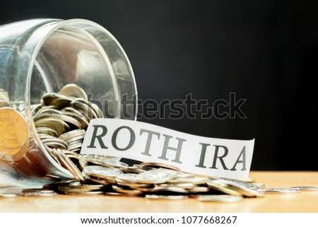 glass jar used for saving US dollar bills and notes for IRA retirement fund