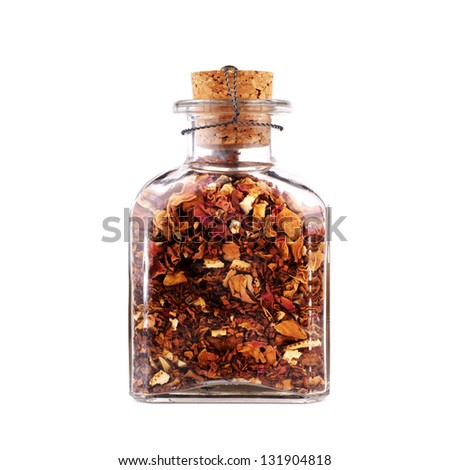 glass jar with colorful flower petals isolated on white background