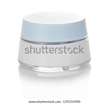 Glass jar with cosmetics isolated on white - stock photo