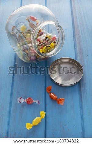 glass jar with mints on one wooden table. Lighting the back lighting