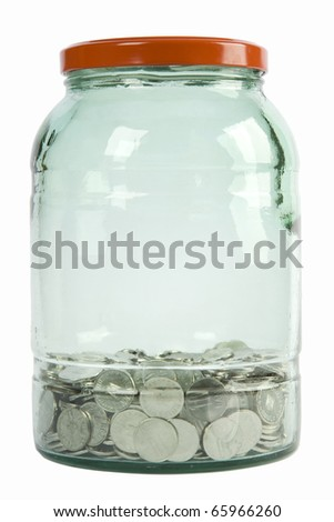 glass jar with silver coins on white background