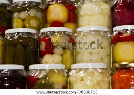 glass jars of colorful pickled vegetables
