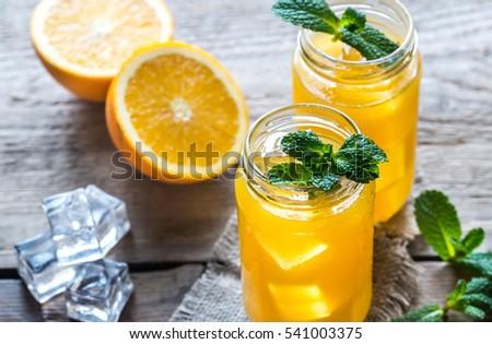 Shutterstock Glass jars of orange juice
