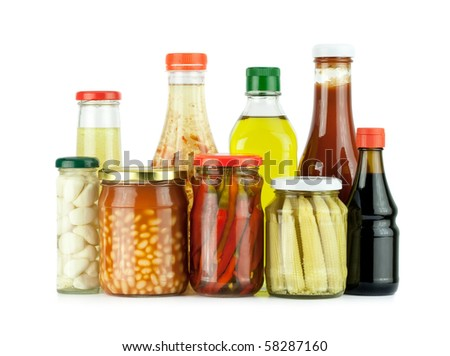 Glass jars of preserved vegetables and sauces