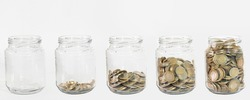 Glass jars with coins, savings concept