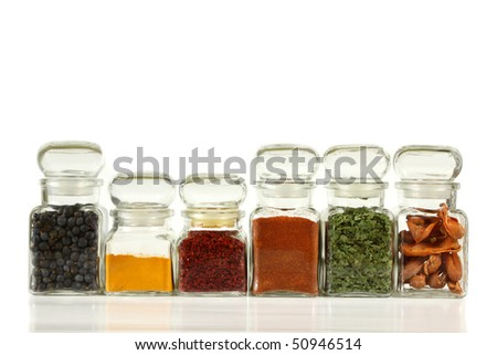 Glass jars with colorful herbs and spices.