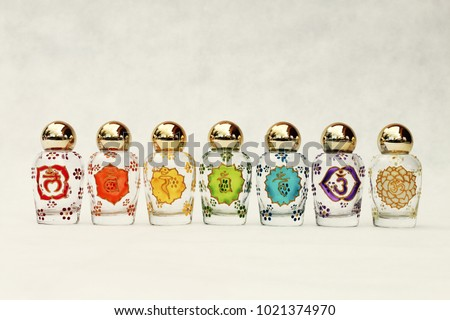 Glass jars with the symbols of the seven Chakras, psychic-energy center in the esoteric traditions of Indian religions #1021374970