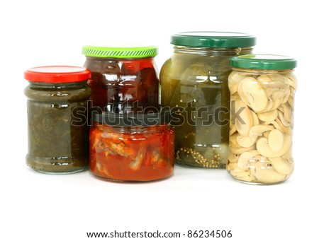 glass jars with tinned products isolated on white background