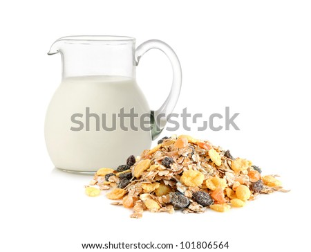 Glass jug with milk and and muesli for balance diet on white background