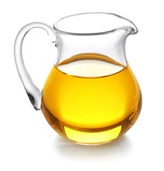 Glass jug with oil on white background