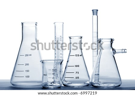 Glass laboratory equipment with conical Erlenmeyer flasks and beaker with scientific cylinder in a science research lab in blue tone over white background (no visible logo or trademark)