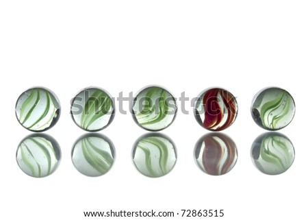 Glass marbles. Illustrating the odd one out concept.