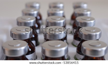 Glass medicine bottles with injection fluid with aluminium caps