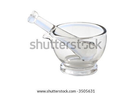 Glass mortal and pestle isolated on a white background.